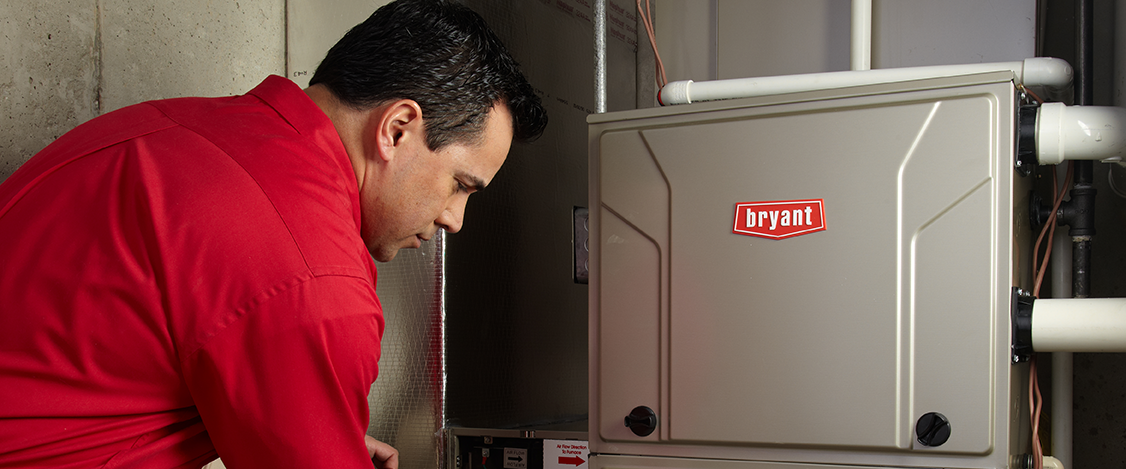 Expert Technician inspecting a unit for potential issues and checking the air filter.